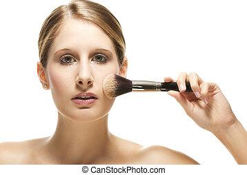beautiful woman put on makeup on white background