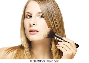 beautiful woman put on makeup with a brush on white background