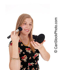 Beautiful woman putting on makeup