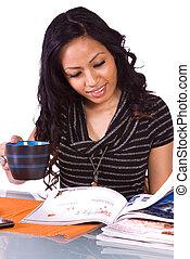 Beautiful Woman Reading a Magazine