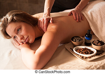 Beautiful woman receiving a massage in a spa.