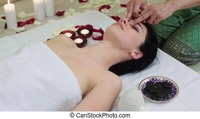 Beautiful Woman Receiving Face Massage in Spa