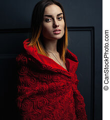 beautiful woman red cloak  in studio