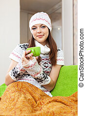 woman relaxing at home with cup