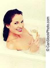 Beautiful woman relaxing during the bath.