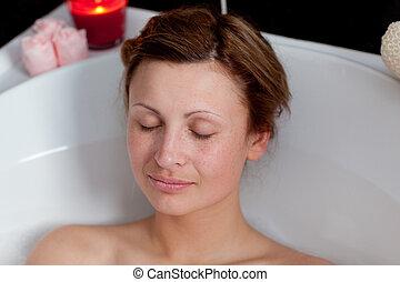 Beautiful woman relaxing in a bath