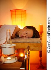 Beautiful woman relaxing in a massage salon
