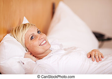 Beautiful Woman Relaxing On A Bed