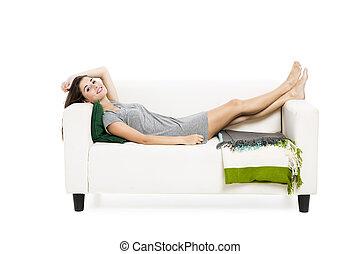 Beautiful woman relaxing on a sofa