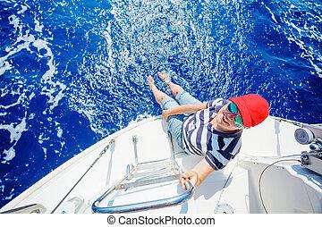 Beautiful woman relaxing On Yacht in Greece