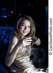 Rich and beautiful - beautiful woman, rest in night club. ...