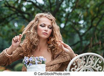 Beautiful woman resting in the garden