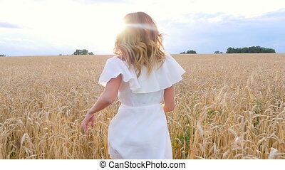 beautiful woman run away in wheat field