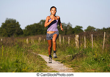 Beautiful woman runner - Beautiful sporty woman running on...