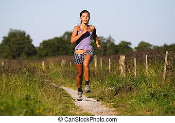 Beautiful woman runner - Beautiful sporty woman running on...