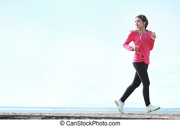 beautiful woman running on the beach