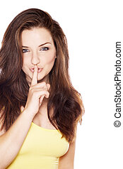 Beautiful woman saying shh - A beautiful young woman with ...