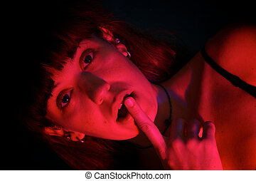 beautiful woman scared in red