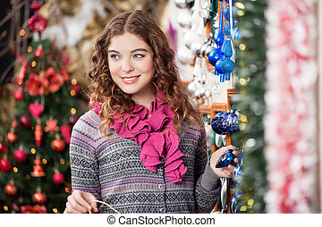 Beautiful Woman Shopping At Christmas Store