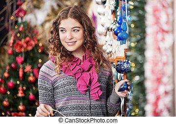 Beautiful Woman Shopping At Christmas Store