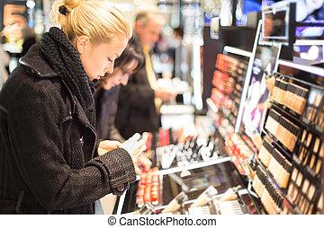 Beautiful woman shopping in beauty store.