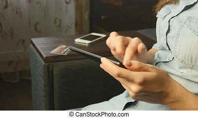 woman shopping online with credit card and tablet at home