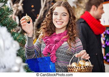 Beautiful Woman Shopping Ornaments At Christmas Store