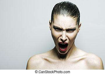 Beautiful woman shouting angry