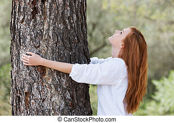 Beautiful woman showing her love of nature