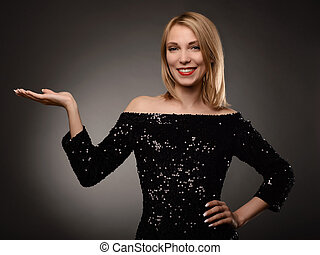 Beautiful woman showing open hand palm with copy space for product or text.