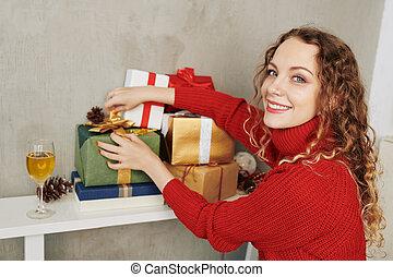 Beautiful woman showing presents