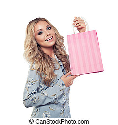 Beautiful woman showing shopping bag isolated
