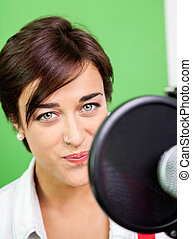 Beautiful Woman Singing In Recording Studio