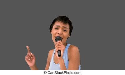 Beautiful woman singing on mike