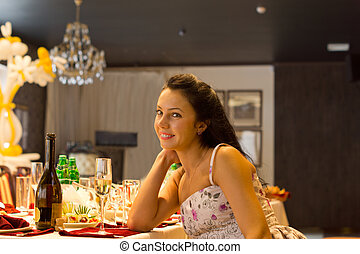 Beautiful woman sitting alone at a formal table