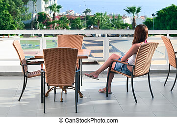 Beautiful woman sitting in balcony