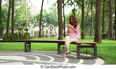 Beautiful woman sitting on a bench