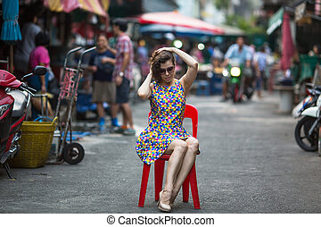 Beautiful woman sitting on a chair