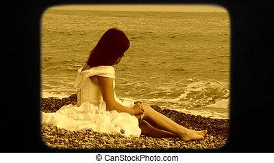 Beautiful Woman Sitting on Beach And Putting On Stockings