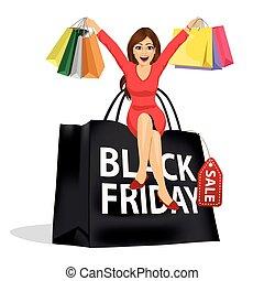 beautiful woman sitting on big black friday shopping bag