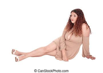 Beautiful woman sitting on floor