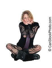 Beautiful woman sitting on floor.