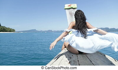Beautiful Woman Sitting On Thailand Boat Nose, Raising Hand...