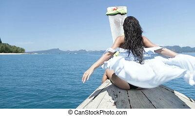 Beautiful Woman Sitting On Thailand Boat Nose, Raising Hand...
