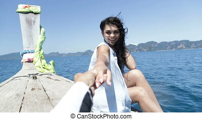Beautiful Woman Sitting On Thailand Boat Nose Holding Man...