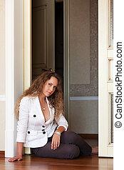 Beautiful woman sitting on the floor