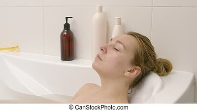 Beautiful woman sleeping in bath.