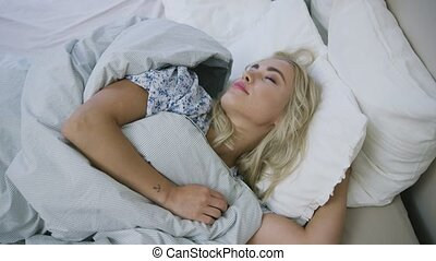 Beautiful woman sleeping inbed