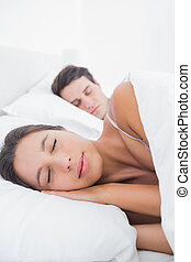 Beautiful woman sleeping next to her partner