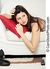 Beautiful woman sleeping on sofa.